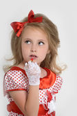 Little girl paints lips with lipstick — Stock Photo