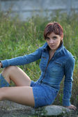 Young fashion model posing in jeans jacket — Foto Stock