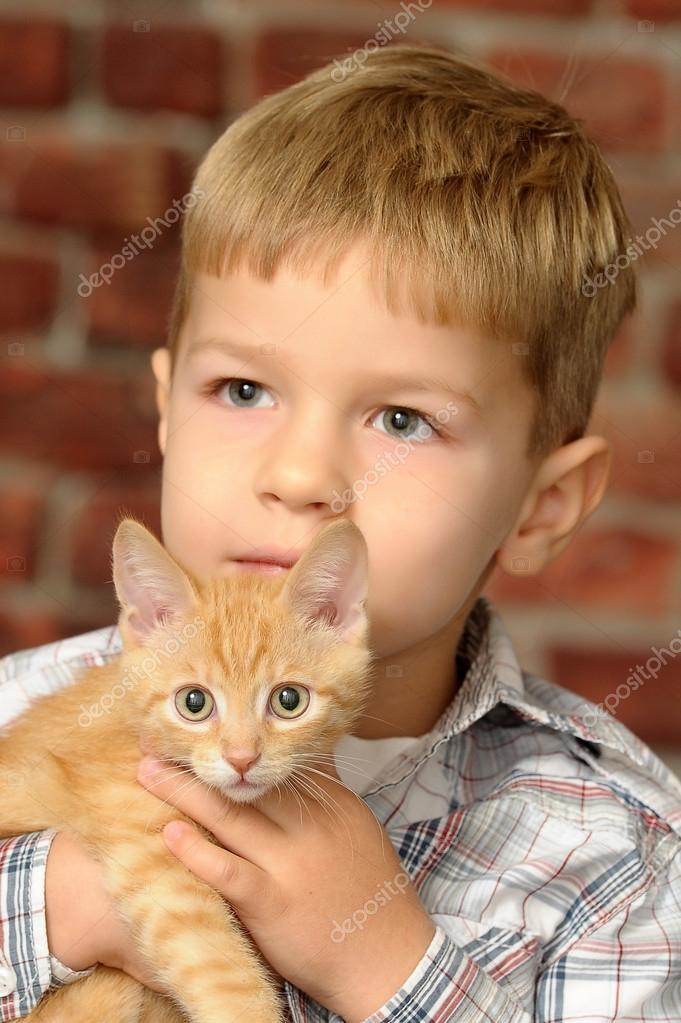 Boy with a small kitten — Photo by evdoha - depositphotos_13902890-Boy-with-a-small-kitten
