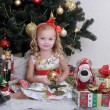 Stock Photo: Cute little girl in front of a Christmas tree