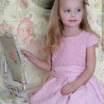Beautiful little girl looking to retro mirror — Stock Photo #16871447