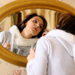 Reflection of young woman in a mirror — Stock Photo #17460939