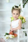 Beautiful girl in white dress with a flower — Stock Photo