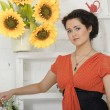 Brunette woman with sunflowers - Stock Photo