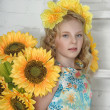Girl with sunflowers — Stock Photo