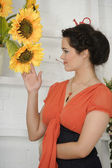 Brunette woman with sunflowers — Stock Photo