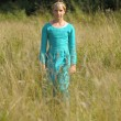 Girl in medieval dress in a field of grass — Stock Photo #18944941