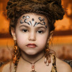 Portrait of girl in ethnic style with dreadlocks — Stock Photo #19162979