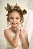 Portrait of a girl with a golden wreath on head — Stock Photo