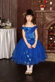 Little girl in an elegant blue dress — Stock Photo