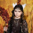 Close up portrait of American Indian girl with feathers head accessory — Stock Photo #23726301