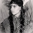 Close up portrait of American Indian girl with feathers head accessory — Stock Photo