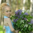 Girl with lilac — Stock Photo