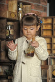 Girl on the old kitchen — Stock Photo