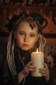 Girl with candles — Stock Photo
