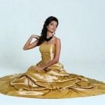 Girl in golden dress — Stock Photo