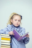 Girl with a lot of books — Stock Photo