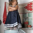 Portrait of a little girl in the kitchen — Stock Photo
