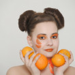 Beautiful girl with oranges — Stock Photo