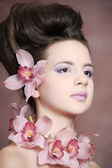 Portrait of charming girl with orchids — Stock Photo
