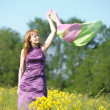 Woman posing in a field — Stock Photo