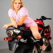Sexy girl posing on a motorcycle — Stock Photo