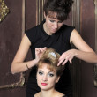 Hairdresser makes hairstyle for young pretty women — Stock Photo