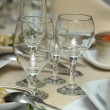 Wine glasses on festive table — Stock Photo