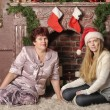 Christmas photo of mother and daughter — Stock Photo #27714329