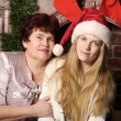 Christmas photo of mother and daughter — Stock Photo #27714345