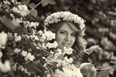 Girl next to a flowering tree — Stock Photo