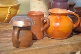 National culture ceramic handmade brown jugs on market — Stock Photo