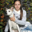 Foto Stock: Girl with dog