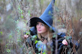 Girl in a witch costume — Stock Photo