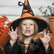 Girl in witch costume on Halloween — Stock Photo #31937241