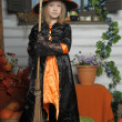 Girl in witch costume on Halloween — Stock Photo