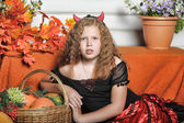 Evil red-haired girl with pumpkin — Stock Photo