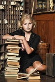 Schoolgirl girl in retro library — Stock Photo