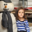 Stock Photo: Girl with a toy snowman