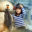 Girl with a toy snowman — Stock Photo