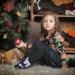 Little girl with gifts near a Christmas tree  — 图库照片