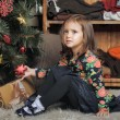 Little girl with gifts near a Christmas tree  — Stock fotografie