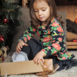 Little girl with gifts near a Christmas tree  — Stock Photo