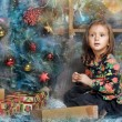 Surprised  girl near the Christmas tree  — Lizenzfreies Foto