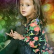 Little girl with gifts near a Christmas tree — Stok fotoğraf