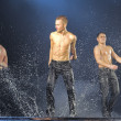Male dancers in the rain — Stock Photo