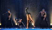 Male dancers in the rain — Stock Photo