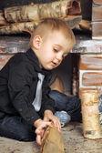Boy near fireplace — Stock Photo
