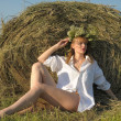 Young woman on the field with big hay bale rolls — Stock Photo #37226857
