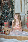 Little girl being happy about christmas present — Stockfoto